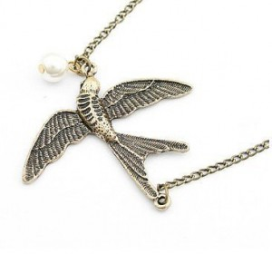 flying bird and pearl necklace