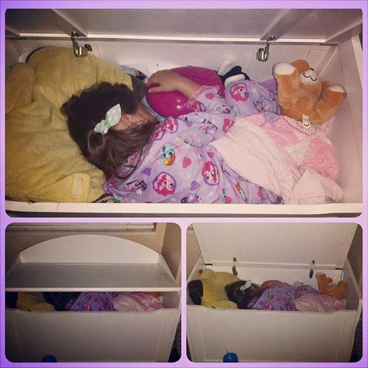 kiddo sleeping in toy box