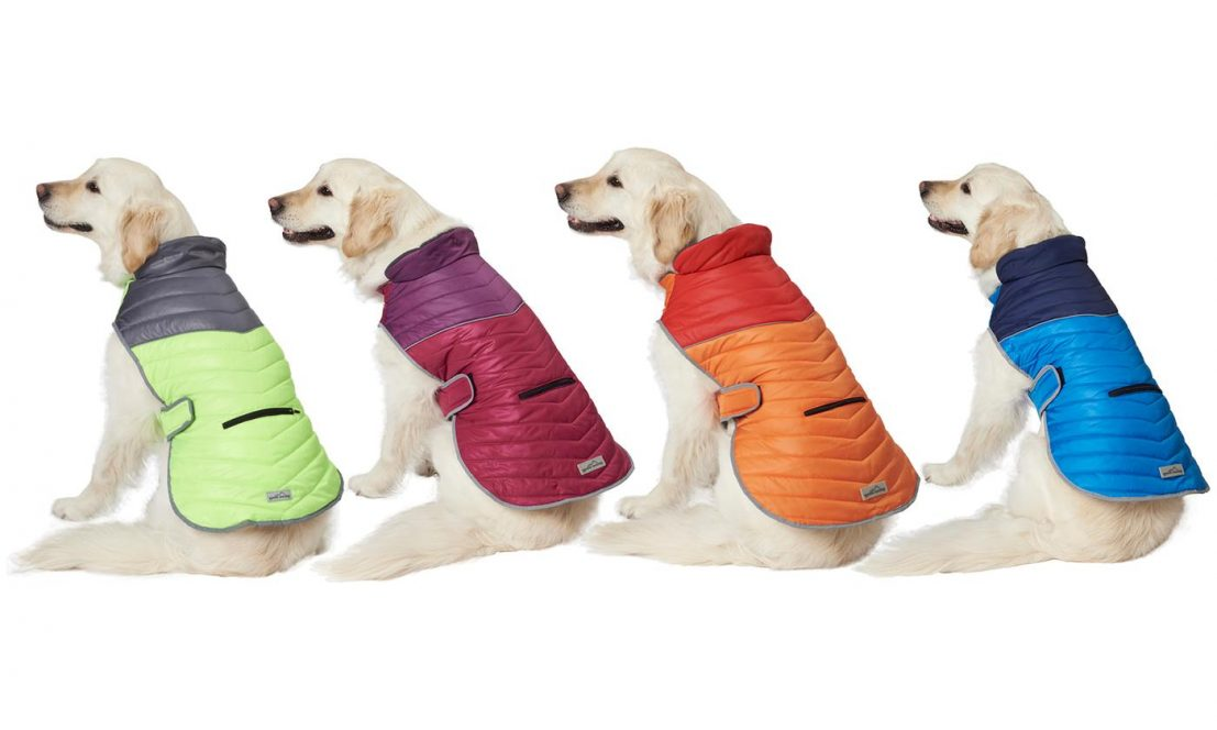 349a0fd89c847 Keep your dog stylishly warm during cold days with this two-tone,  triple-layer, water-repellent puffer with a functional zippered pocket.